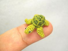 Handmade crochet miniature animals - micro mini green sea turtle is made of embroidery threads, micro plastic eyes and stuffed by polyfil. Size: Aprox.