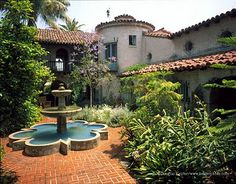 Gorgeous tiered Spanish fountain. . . And the lush plantings set off the hardscape perfectly. Check out more tiered fountain photos at http://www.landscapingnetwork.com/fountains/tiered.html