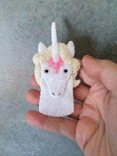 The Last Unicorn Unicorn Felt Finger Puppet by LumpyButtonsGifts on Etsy https://www.etsy.com/listing/254810592/the-last-unicorn-unicorn-felt-finger