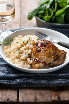 One Pot Creamy Parmesan Garlic Risotto With Lemon Pepper Chicken - olive oil - chicken - Lemon Pepper seasoning - Risotto - butter - 4 garlic cloves - onion - arborrio risotto rice - chicken broth or stock - low fat milk - salt - pepper - freshly grated parmesan cheese - fresh thyme or oregano - fresh parsley