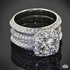 Custom fantasies brought to life 1.02ct F VS1 A CUT ABOVE Diamond set in a decadent custom platinum engagement ring holding approximately .75ctw A CUT ABOVE Diamond melee and two custom diamond bands soldered together
