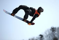 An athlete trains for snowboard slopestyle ahead of the Pyeongchang 2018 Winter Olympic Games at Phoenix Snow Park on February 8, 2018, in Pyeongchang, South Korea.