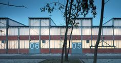 Image 1 of 12 from gallery of Wrocław Technology Park Complex Refurbishment / Major Architekci. Photograph by Krzysztof Smyk Industrial Sheds, Industrial Office Design, Industrial Park, Industrial Architecture, Space Architecture, Modern Industrial, Architecture Details, Parking Building, Factory Architecture