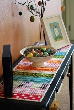 Quilted table runner - already made something similar but like how this is used on side table