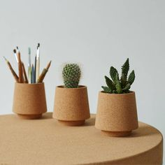 Hand turned stackable cork vessels, perfect to use as neat little desk tidies or…