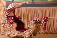 The beautiful bride will look even more beautiful riding amid flowers. #indianwedding #weddinginindia #weddingdecor #weddingstage #weddingtheme #weddinglighting #flowerdecor #weddingplanner #eventplanner #palki #doli