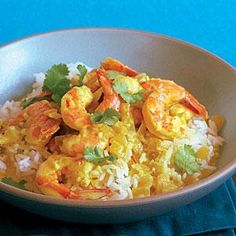 Coconut Shrimp Curry by Sunset Magazine. In just a few minutes, warm spices and creamy coconut milk cook into a rich, satisfying sauce for shrimp and rice. Curry Recipes, Fish Recipes, Seafood Recipes, Indian Food Recipes, Asian Recipes, Cooking Recipes, Healthy Recipes, Thai Recipes, Delicious Recipes