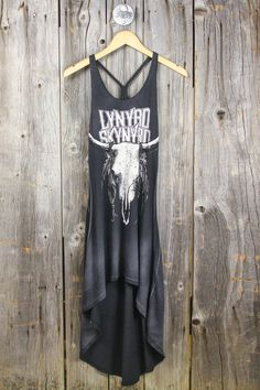 We are bringing back the favorite Lynyrd Skynyrd graphic, but this time on an amazing hi-low t-shirt dress. · 100% Cotton · Extremely Soft + Washed Look · Braided Straps · Made in USA