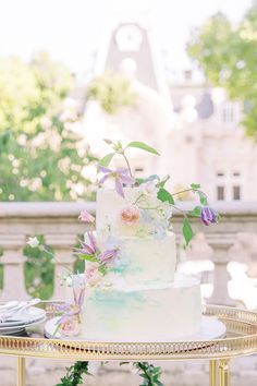 """From the editorial """"A Heart-Warming Summer Wedding in a Portuguese Palace With Just 14 Guests."""" This white wedding cake with subtle pops of color has completely wowed us! The full gallery is on stylemepretty.com!  Photography: @dianesoterophoto  #weddingcake #summerweddingcake #weddingcakedesign #weddingcakeinspo"""
