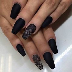 Laced Black Matte Coffin Nails. Lace up your nails with the matte black color and the lace design on the ring finger to create an awesome look.