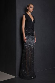 Long fitted Lace evening gown with skirt gradating in shades of silver and Black embroidered Tulle, V neckline and Moroccan Crepe bust.