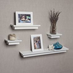 This set of 4 white cornice floating shelves with 2 matching picture frames adds depth to your room by giving the illusion of floating on the wall and gives a contemporary feel to your room decor. These contoured ledges offer a classic molding profile.