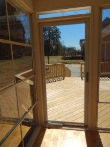3-season room and wood deck in Summerfield NC.  The addition of eze breeze windows creates a 3 or even 4 season room depending upon the weather.