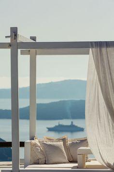 simple white wooden pergola seating with linen drapes - aenaon villas santorini greece