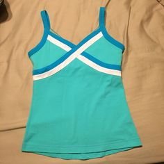 Lululemon Tank Top EUC. Very minimal piling not really noticeable. No rips/stains/holes. Non smoking and pet free home. No tag but it's a size 2. lululemon athletica Tops Tank Tops