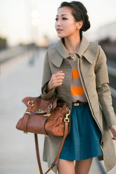 A teal skirt adds a fun pop of color in this neutral outfit.