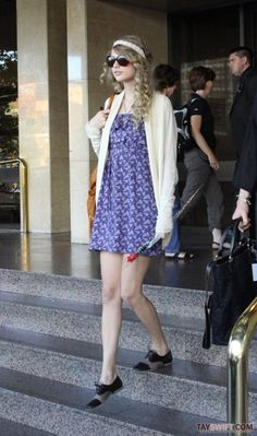 Taylor Swift in a blue dress and cardigan