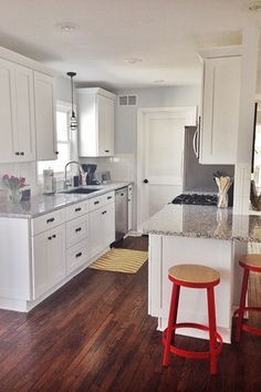 Traditional Kitchen with 2 in. Quartz Countertop in Alpina White, Subway Tile, Flat panel cabinets, Louvered door, Flush