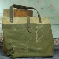 $85.00 reclaim Tote Bag from vintage military bags. Leather handles and two inside pockets make this your go to tote!!!