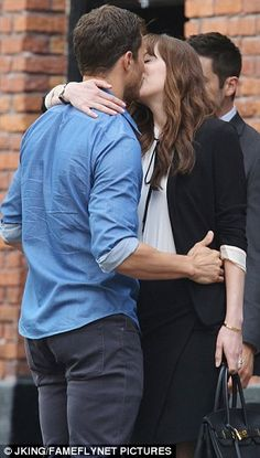 On screen chemistry: During the kissing scene, Jamie, who plays Christian Grey…