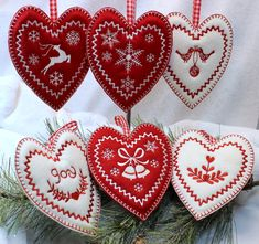 These 6 folkloric style hearts are entirely made in the 5x7 hoop. The edges are stitched by the embroidery machine with a blanket stitch, giving each item a handmade look. These hearts are puffed, not stuffed. Layers of Warm and Natural batting are used to achieve the puffy look.
