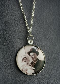 Send us your photo, graphic, or drawing and we will handcraft a unique disk necklace featuring your image. We will scale your image before capturing it under clear acrylic and place it in a silver-tone bezel.
