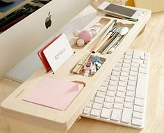 Keep your gadgets and stationaries organized and at easy reach when you have a Korean wooden keyboard shelf that fits perfectly above your desktop keyboard.
