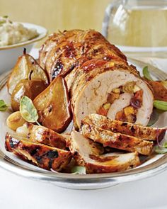 Spicy Fruit-Stuffed Pork Loin with Roasted Pears and Onions. Nice for Christmas Eve.