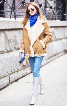 Chiara Ferragni wearing an Acne Studios shearling coat, Redun jeans, and Saint Laurent glitter boots