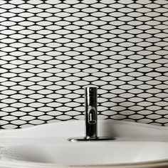 The SomerTile 12x12.5-inch Pisces Glossy Blanco Ceramic Mosaic Floor and Wall Tile captures a unique oval design. This mosaic features a uniform white tone and a high-gloss finish.
