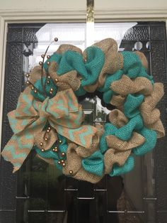 A personal favorite from my Etsy shop https://www.etsy.com/listing/281013458/light-teal-and-natrual-burlap-wreath
