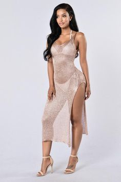 - Available in Rose Gold and Gold - Maxi Cover Up - Metallic Durable Material - Slits on Both Sides - V Neckline - Tank Straps - Low Cut Back - 77% Viscose 23% Metallised