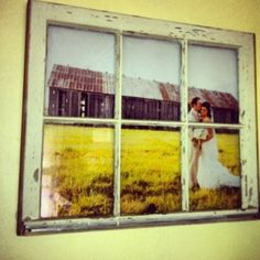 Get a blown-up size of your favorite photo and frame with a vintage window frame! Genius!! #home #decor #photo by lora
