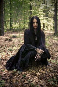 Who is she looking at? What is she going to say? Why is she in the woods? What do the long clothes cover?