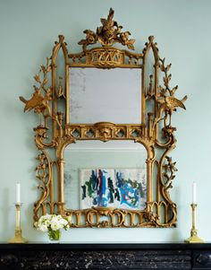 An antique Chippendale giltwood mirror reflects a vivid and modern Joan Mitchell diptych
