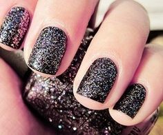 Black sparkley nail polish.♥
