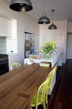 T01 Architecture - Great joinery, pendant lights and unique kitchen island/dining table.  Great colour matching - sea blue and yellow.