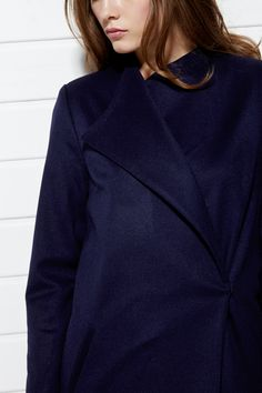 #PLAKINGER #SS15 #collection #LOOK VIII Navy #blue #coat #tailored from a #sumptuous virgin #wool and #angora blend. Straight cut, slim stand collar, padded shoulders, self-tie belt, concealed snapped fastening on the waist, slant pockets, body lined in navy blue and sleeves in #pastel blue #pinstriped viscose. #byplakinger.com #fashion #style #emergingdesigners #designerdiary #designer #navyblue #springsummer2015 #ss2015 #feminine #womenswear #womensfashion #fashiondesign