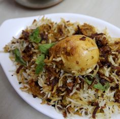 Hyderabadi Egg Biryani is an authentic dum biryani recipe in hyderabadi style made using eggs. Biryani is a special rice delicacy in India and hyderabad too Hyderabadi Biryani Recipe, Hyderabadi Cuisine, Dum Biryani, Iranian Cuisine, Rice Recipes, Indian Food Recipes, Dinner Recipes, Cooking Recipes, Arabic Recipes