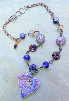 Golden Twilight:  Wire-worked beaded necklace, lampwork, ceramic heart, silk ribbon, antiqued copper