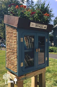 """Jill Wegrzyn. West Hartford, CT. This #LittleLibrary with a rooftop garden and wine-cork siding is awesome! """"This Little Library is located at the intersection of Westfield and Ware! Our custom design has authentic (and previously-appreciated) wine cork siding! Come by and enjoy!"""""""