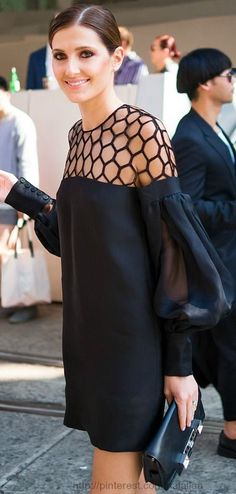 Stunning ... the honeycomb cutout shoulder and puffy sleeve detail create visual interest for this shift dress.
