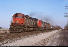 » Mile 37.6 CN Dundas Sub (more..) » Princeton, Ontario, Canada (more..) » November 07, 1982 Locomotive No./Train ID Photographer » CN 2323 (more..) » CN 415 (more..) » Aleks Stefanovic (more..) » Contact Photographer · Photographer Profile Remarks & Notes CN 415 at track speed westbound through Princeton with CN 2323 - CN 2012 - CN 2005 and 81 cars with CN van 79524.