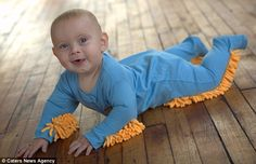 Ingenious: The £25 Baby Mop allows children to clean the floor as they learn to crawl  :D  ** Now I understand why the Princess refuses to crawl!! LOL **