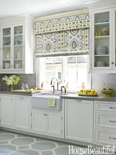 white kitchen cabinet, light grey backsplash, with beautiful window blind