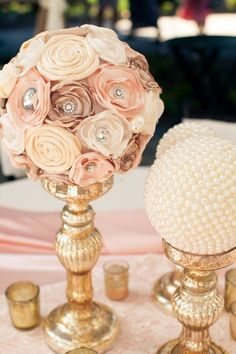 Ribbon roses make for pretty centerpieces. | 21 Beautiful Non-Traditional Ways To Do Wedding Flowers