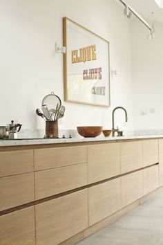 Kitchen by Robert Vialle oak cabinets and carrara marble