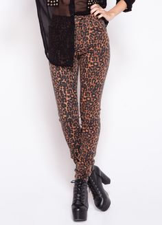 Leopard print high-waisted jeans by Tripp NYC.   97% cotton, 3% spandex Model is wearing size 25