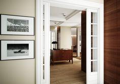 Ekskluzywna aranżacja wnętrz domu w stonowanych barwach - Tissu. Eleganckie wnętrze urządzone stylowymi meblami, ustawionymi w przestronnym lustrzanym hallu. Eleganckie i lekko stylizowane meble, frezowane drzwi, sufity podwieszone z oświetleniem nadają wnętrzu eleganckiego charakteru. Nowoczesności natomiast dodają prostefronty szaf, lustra klejone na całych ścianach czy dodatki. http://www.tissu.com.pl/zdjecia/413