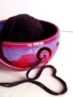 Purple Blue Spiral Ceramic Wheel Thrown Yarn Bowl by NewMoonStudio, $38.00 I am not a knitter, but I would get the bowl anyway just because it's so pretty.